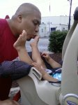 Baby getting toes kissed by Buddhist monk