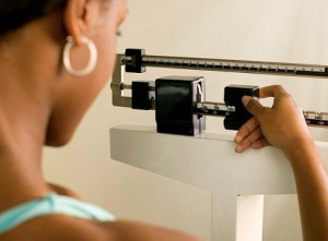 contraceptives and weight  - woman on scale