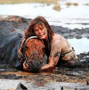 Woman saving horse