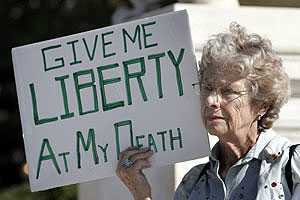 Senior Citizen with sign - Give Me Liberty at my Death