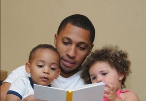 Dad reading to kids
