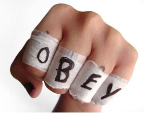 Obey written on hand