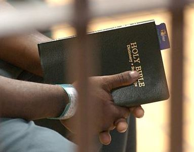 prisoner with Bible