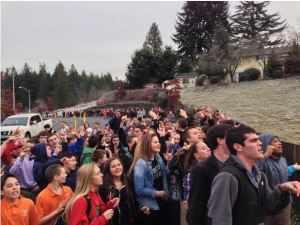 Eastside Catholic - students by fence