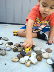 Child playing with rocks